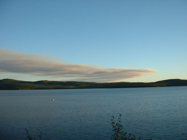 Smoke from a forest fire across the lake.